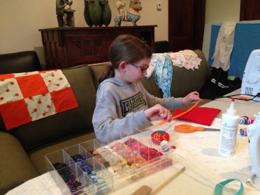 Maggy's daughter Sophie sewing